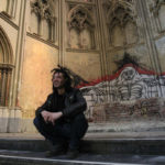 """Sergio Aruajo from Brazil sits in the church at the """"Gesu Squat,"""" an abandoned convent, in Brussels in this April 18, 2013 file photo. The giant building, once a church and a convent, may be turned into a hotel and luxury apartments should a project proposed by a Swiss developer get the green light, leading to the expulsion of all its residents. REUTERS/Yves Herman/Files (BELGIUM - Tags: SOCIETY POVERTY REAL ESTATE BUSINESS IMMIGRATION)"""
